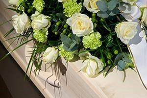 boquet of flowers on coffin